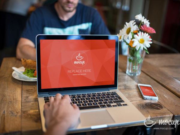 MacBook with iPhone in Restaurant Scene Mockup  mockup, free mockup, psd mockup, mockup psd, free psd, psd, download mockup, mockup download, photoshop mockup, mock-up, free mock-up, mock-up psd, mockup template, free mockup psd, presentation mockup, branding mockup, free psd mockup