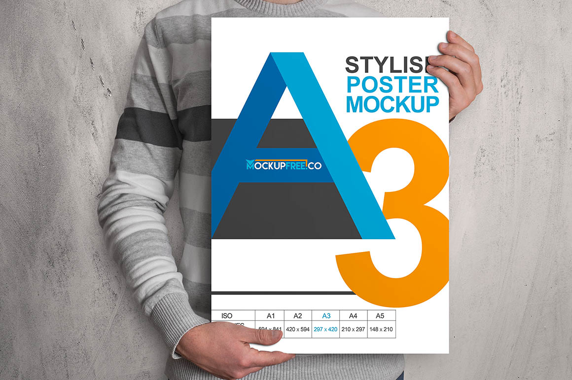 Man Holding A3 Poster Mockup PSD