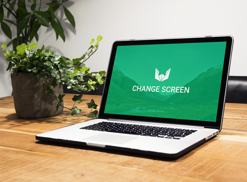 Macbook on Wooden Table with Plants Mockup