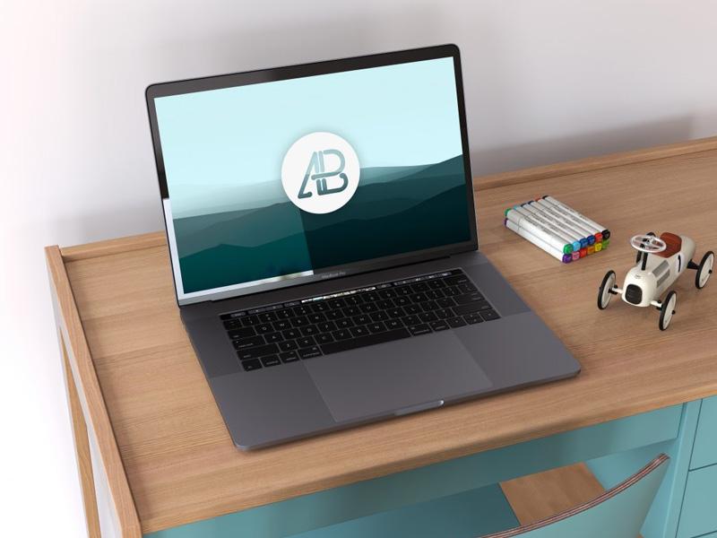 Space Gray Macbook Pro on Desk Mockup