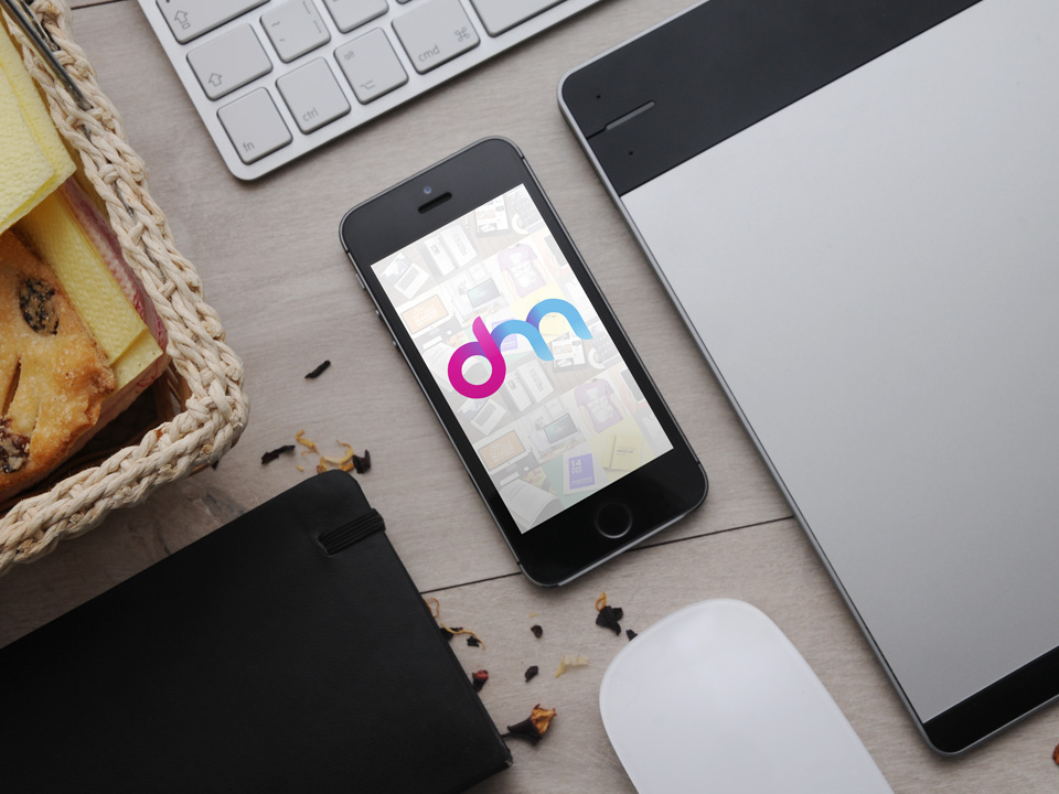 iPhone on Table Mockup Free PSD
