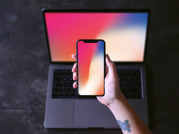 iPhone X in Hand with Macbook Mockup  mockup, free mockup, psd mockup, mockup psd, free psd, psd, download mockup, mockup download, photoshop mockup, mock-up, free mock-up, mock-up psd, mockup template, free mockup psd, presentation mockup, branding mockup, free psd mockup