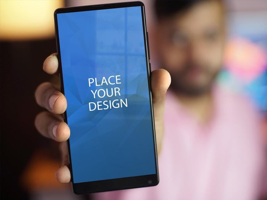 Man Holding Smartphone Mockup
