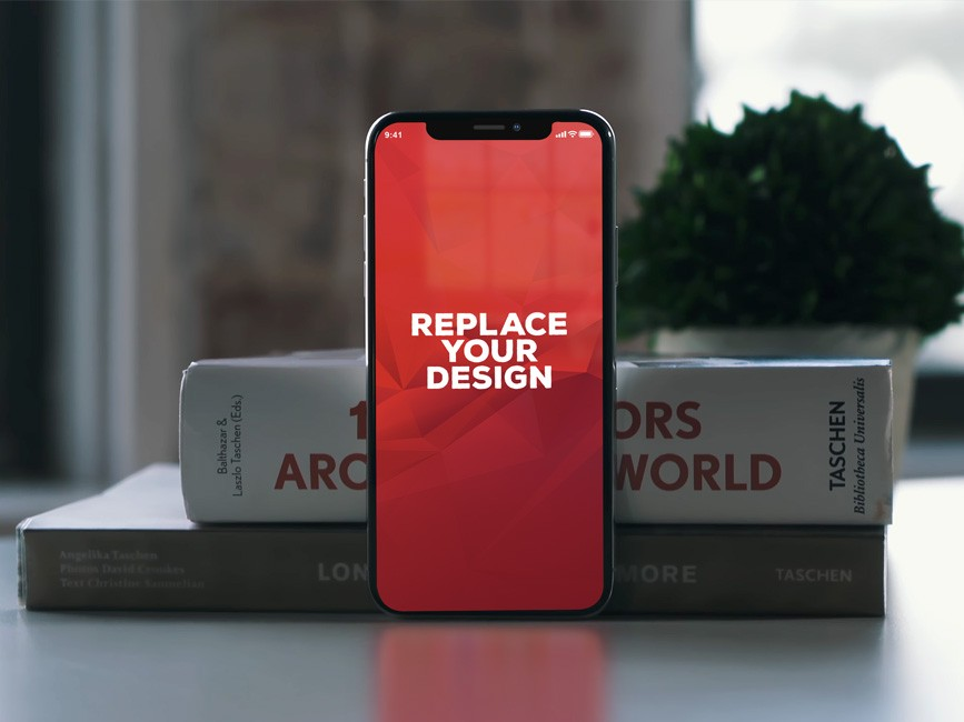 iPhone X with Books Free Mockup
