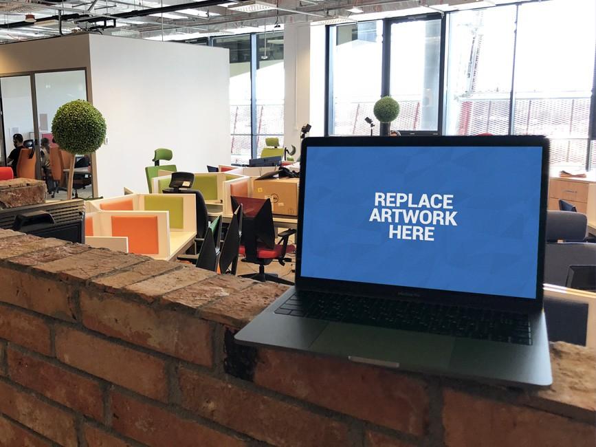 Macbook in Office Space Mockup