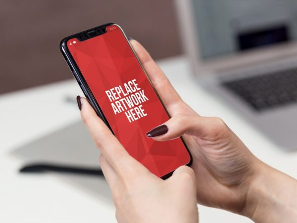Female Hand holding iPhone X Mockup  mockup, free mockup, psd mockup, mockup psd, free psd, psd, download mockup, mockup download, photoshop mockup, mock-up, free mock-up, mock-up psd, mockup template, free mockup psd, presentation mockup, branding mockup, free psd mockup