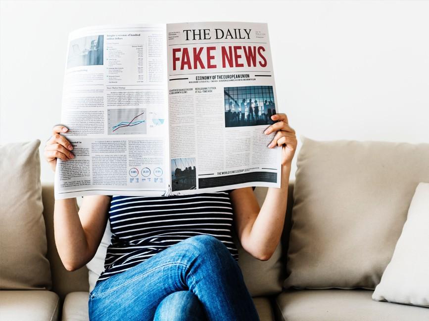 Woman Reading Newspaper Mockup