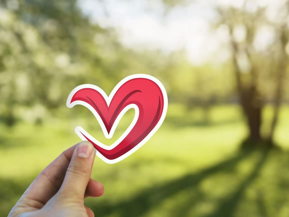 Hand Holding Sticker Mockup - Mockup Love