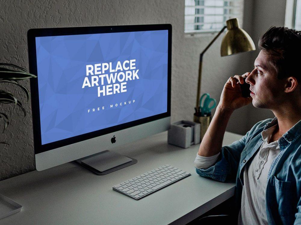 Man Working at iMac Mockup  mockup, free mockup, psd mockup, mockup psd, free psd, psd, download mockup, mockup download, photoshop mockup, mock-up, free mock-up, mock-up psd, mockup template, free mockup psd, presentation mockup, branding mockup, free psd mockup