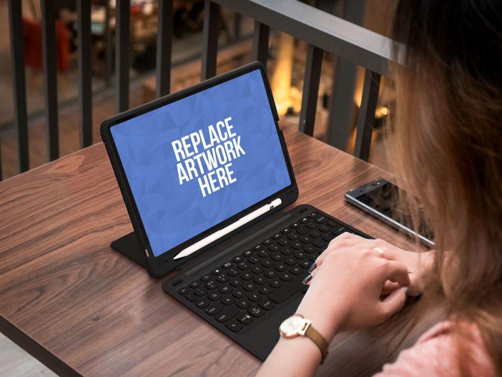 Woman Working on iPad Mockup  mockup, free mockup, psd mockup, mockup psd, free psd, psd, download mockup, mockup download, photoshop mockup, mock-up, free mock-up, mock-up psd, mockup template, free mockup psd, presentation mockup, branding mockup, free psd mockup