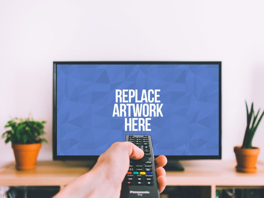 Smart TV with Hand Holding Remote Mockup